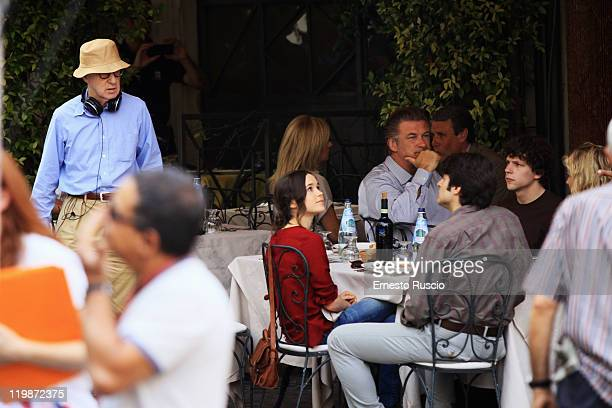 Director Woody Allen actors Ellen Page Alec Baldwin and Jesse Eisemberg look on during the filming of 'To Rome With Love' at Piazza Madonna Dei Monti...