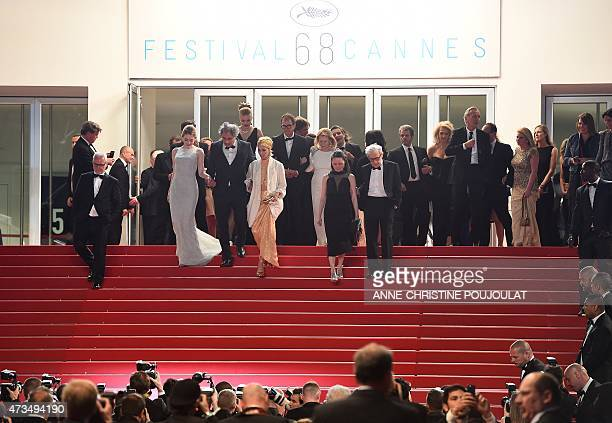 US director Woody Allen and his wife SoonYi leave the Festival palace with US actress Parker Posey and US actress Emma Stone after the screening of...