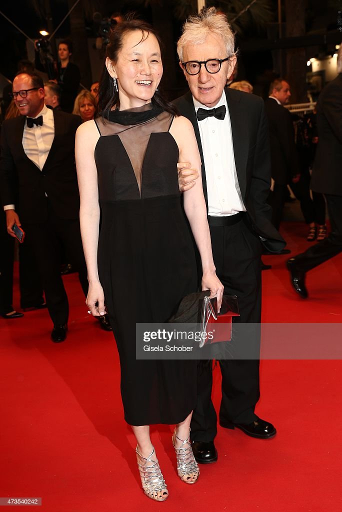 Director Woody Allen and his wife Soon-Yi Previn depart the Premiere of 'Irrational Man' during the 68th annual Cannes Film Festival on May 15, 2015 in Cannes, France.