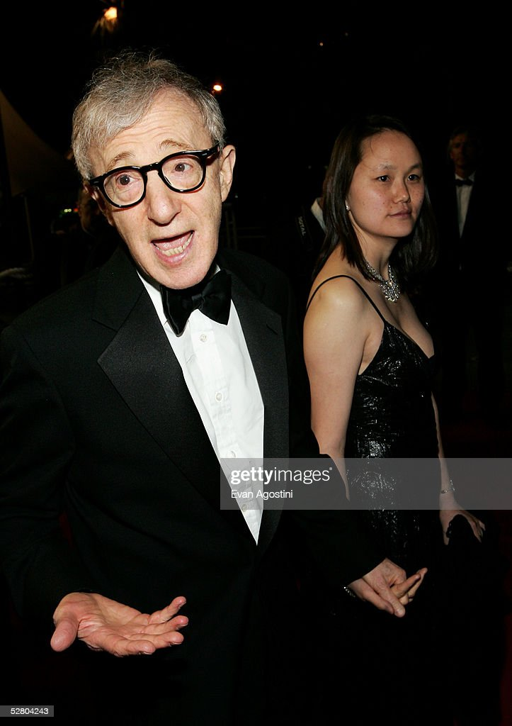 Director Woody Allen and his wife Soon-Yi Previn depart the premiere of the film 'Match Point' at the Palais during the 58th International Cannes Film Festival May 12, 2005 in Cannes, France.