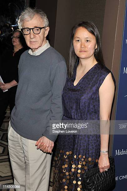 Director Woody Allen and SoonYi Previn attend the Cinema Society Thierry Mugler screening of Midnight in Paris at the Tribeca Grand Screening Room on...