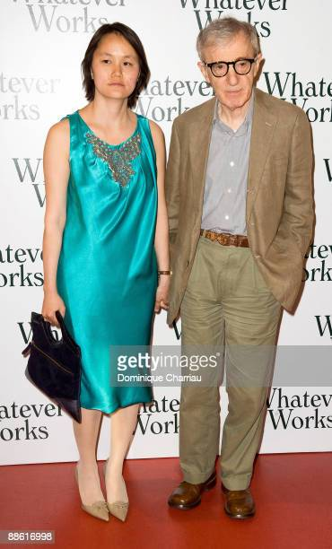 Director Woody Allen and wife SoonYi Previn attend the 'Whatever Works' Paris premiere at Cinema Gaumont Opera on June 19 2009 in Paris France