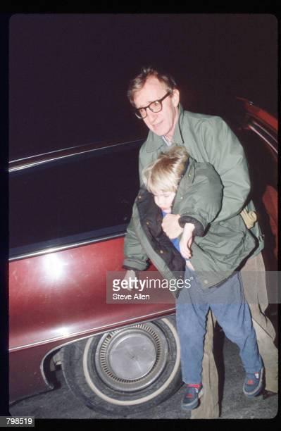 Director Woody Allen carries his son Satchel February 8, 1993 in New York City. Allen's ex-girlfriend Mia Farrow is filing for custody of their...