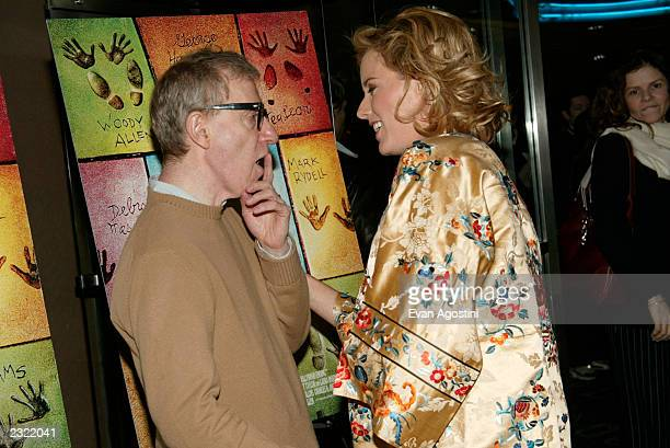 Director Woody Allen chats with actress Tea Leoni at the Hollywood Ending film premiere at Chelsea West Cinema in New York City April 23 2002 Photo...