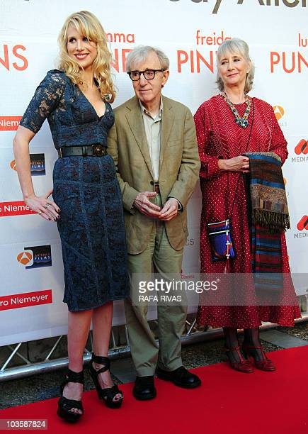 US director Woody Allen poses flanked by actresses Lucy Punch and Gemma Jones on the red carpet as he arrives at the premiere of his latest film �You...
