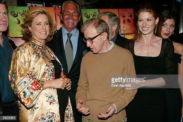 Director Woody Allen poses with cast Tea Leoni George Hamilton Debra Messing and Tiffani Thiessen at the Hollywood Ending film premiere at Chelsea...