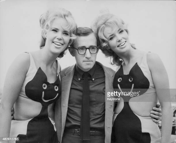 Director Woody Allen posing with twins Valerie and Leila Croft at the Dorchester Hotel London August 16th 1965