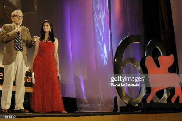 Director Woody Allen speaks as actress Alessandra Martinez looks on during the opening ceremony of the 60th Venice Film Festival August 27, 2003 in...