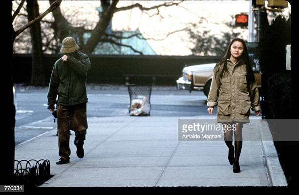 Director Woody Allen walks with girlfriend Soon Yi Previn January 23 1993 in New York City Allen's exgirlfriend Mia Farrow is filing for custody of...