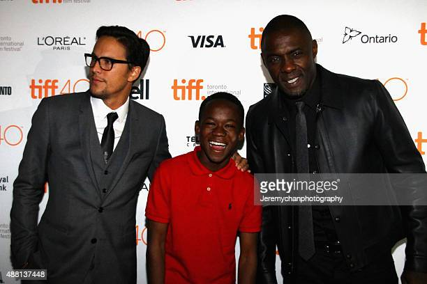 Director / Writer Cary Fukunaga actor Abraham Attah and actor Idris Elba attend the 'Beasts Of No Nation' premiere during the 2015 Toronto...