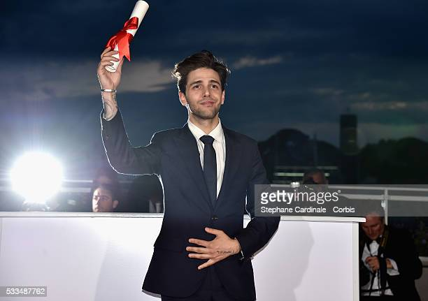Director Xavier Dolan poses after being awarded The Grand Prix for the movie 'Just the end of the world' during the Palme D'Or Winner Photocall...