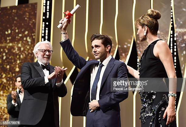 Director Xavier Dolan poses on stage after being awarded with The Grand Prix for the movie 'Just the end of the world' next to jury members Donald...