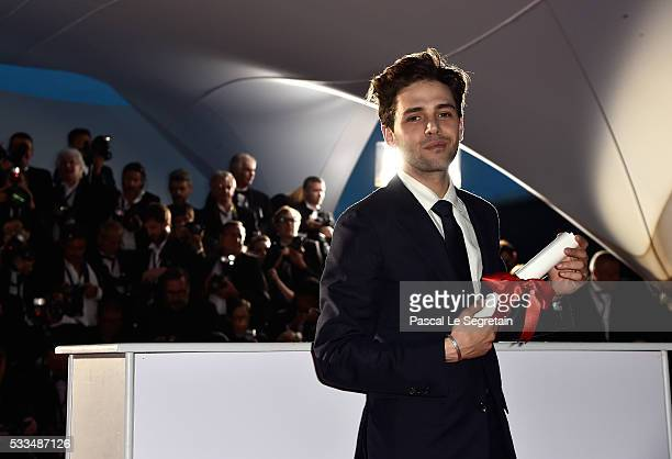 Director Xavier Dolan poses with The Grand Prix for the movie 'Just the end of the world' at the Palme D'Or Winner Photocall during the 69th annual...
