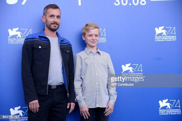 Director Xavier Legrand and actor Thomas Gioria attend the photocall of the movie 'Jusqu'à la Garde' presented in competition at the 74th Venice Film...