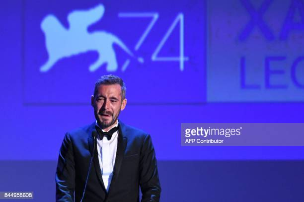 Director Xavier Legrand reacts as he receives the Silver Lion for Best Director award with the movie 'Jusqu'à la Garde' from actress and president of...