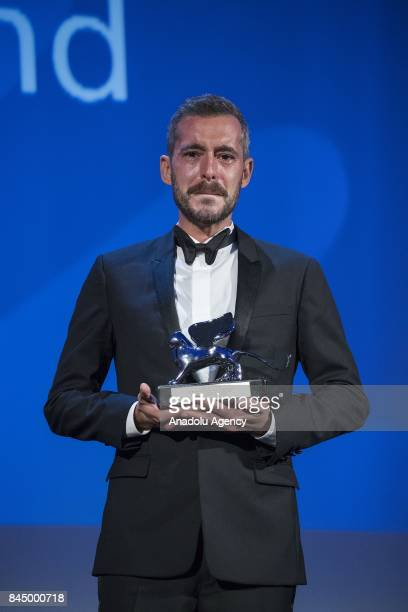 Director Xavier Legrand wins the Silver Lion Best Direction and the Lion of the Future for the film 'Jusqu'à la Garde' during Ceremony Awards of the...