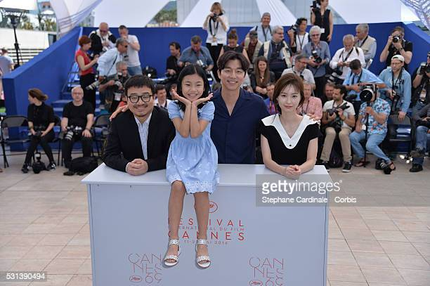 """Director Yeon Sang-ho, actors Kim Su-an, Gong Yoo and Jung Yu-mi attend the """"Train To Busan """" photocall during the 69th Annual Cannes Film Festival..."""