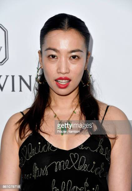 Director Yi Zhou attends the amfAR Gala at Ron Burkle's Green Acres Estate on October 13 2017 in Beverly Hills California