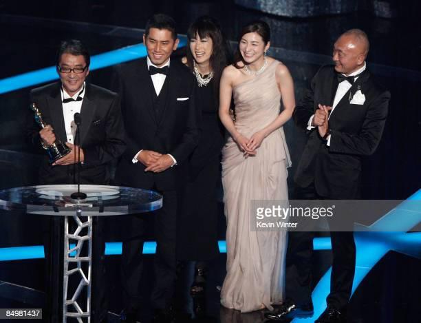 Director Yojiro Takita actor Masahiro Motoki actresses Kimiko Yo Ryoko Hirosue and executive producer Yasuhiro Mase accept the Best Foreign Language...