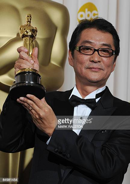 Director Yojiro Takita holds the trophy after being awarded Best Foreign Language Film of the Year at the 81st Academy Awards at the Kodak Theater in...