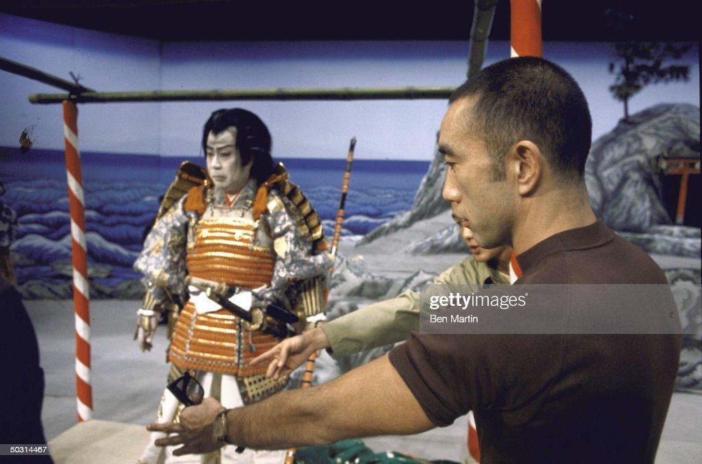 Director Yukio Mishima (R) directing an actor in a play based on an ancient samarai legend.