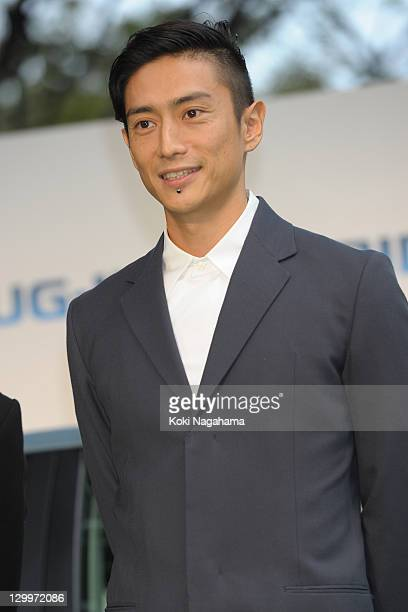 Director Yusuke Iseya poses on the green carpet during the Tokyo International Film Festival Opening Ceremony at Roppongi Hills on October 22, 2011...
