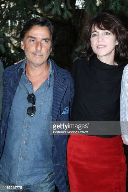 Director Yvan Attal and his companion Charlotte Gainsbourg attend the 12th Angouleme FrenchSpeaking Film Festival Day One Mon Chien Stupide photocall...
