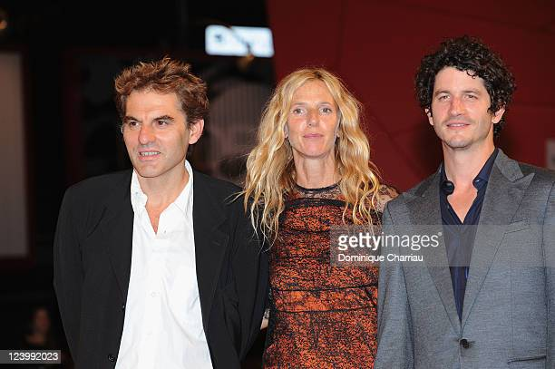 Director Yves Caumon actors Sandrine Kiberlain and Clement Sibony attend the 'L'Oiseau' premiere during the 68th Venice International Film Festival...