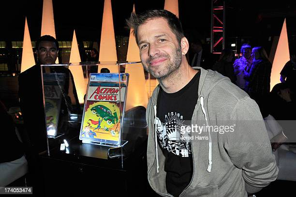 Director Zack Snyder poses in front of Action Comics issue at DC Entertainment and Warner Bros host Superman 75 party at San Diego ComicCon at Hard...