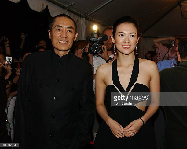 Director Zhang Yimou and actor Zhang Ziyi pose for the cameras on the red carpet ant the North American premiere of 'House of Flying Daggers' during...