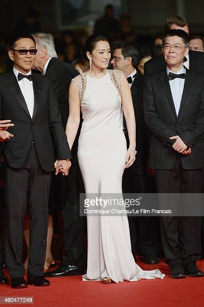 director Zhang Yimou Chinese actress Gong Li and actor Chen Daoming attend the Coming Home Premiere during the 67th Annual Cannes Film Festival on...