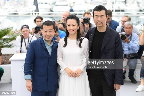 Director Zhangke Jia actress Tao Zha and actor Fan Liao attend the photocall for the 'Ash Is The Purest White ' during the 71st annual Cannes Film...