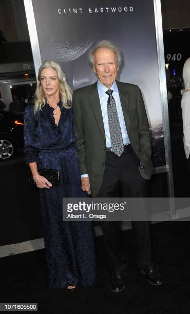 Director/actor Clint Eastwood and Christina Sandera arrive for the Warner Bros Pictures World Premiere Of The Mule held at Regency Village Theatre on...