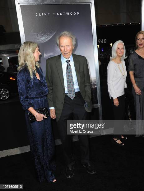 "Director/actor Clint Eastwood and Christina Sandera arrive for the Warner Bros. Pictures World Premiere Of ""The Mule"" held at Regency Village Theatre..."