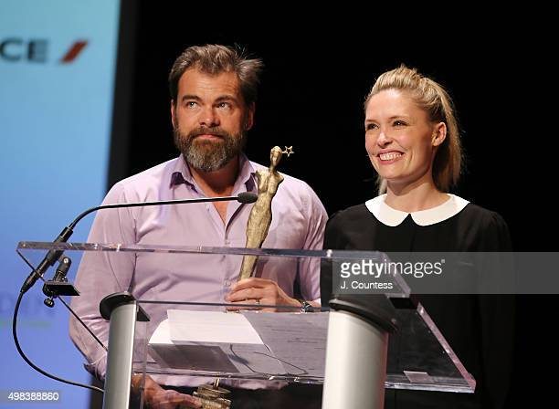 Director/actor Clovis Cornillac and cowriter/actress Lilou Fogli accept the 2015 In French Audience Award at the 2015 In French With English...
