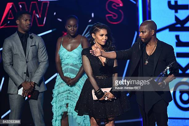 Director/actor Nate Parker and actress Aja Naomi King look on as Tammy Collins and recording artist Kirk Franklin accept the Best...
