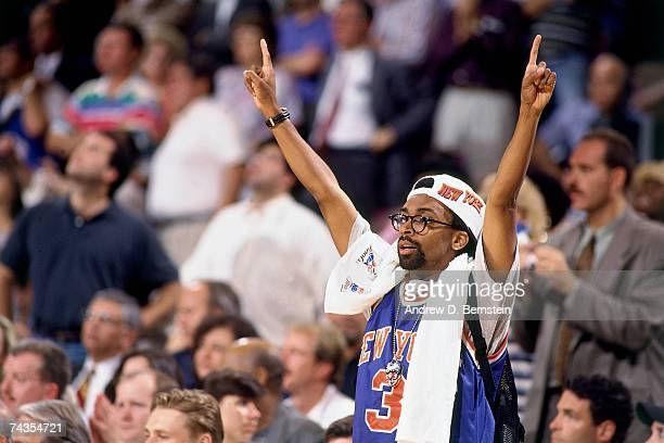 Director/Actor Spike Lee holds his arms up during Game Five of the NBA Finals between the Houston Rockets and the New York Knicks played on June 17...