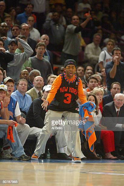 Director/actor Spike Lee yells from his courtside seats in Game three of the Eastern Conference Quarterfinals during the NBA Playoffs between the New...