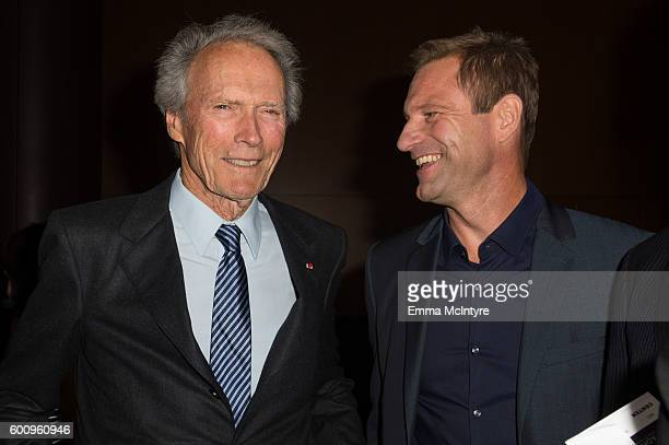 Director/actor/producer Clint Eastwood and actor Aaron Eckhart attend the screening of Warner Bros Pictures' 'Sully' at Directors Guild Of America on...
