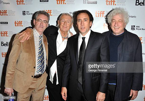 Director/CEO of TIFF Piers Handling director Joel Schumacher actor Nicolas Cage and executive producer Avi Lerner arrive at Trespass Premiere at Roy...