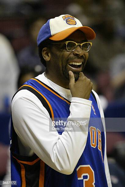 Director/Diehard New York Knicks fan Spike Lee smiles during Game One of the Eastern Conference Quarterfinals of the 2004 NBA Playoffs against the...