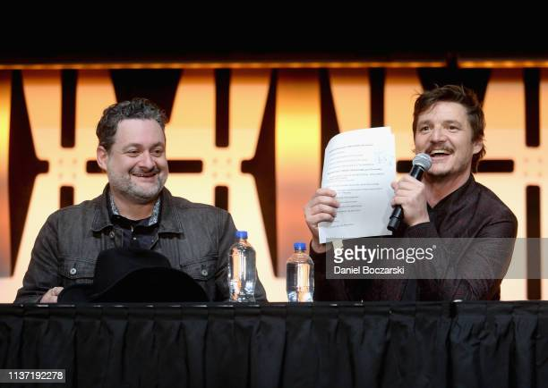 Director/executive producer Dave Filoni and Pedro Pascal onstage during The Mandalorian panel at the Star Wars Celebration at McCormick Place...