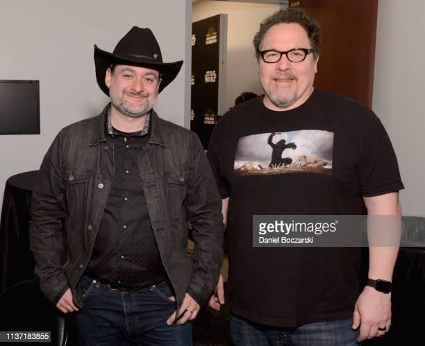 "Director/executive producer Dave Filoni and Writer/executive producer Jon Favreau attend ""The Mandalorian"" panel at the Star Wars Celebration at..."