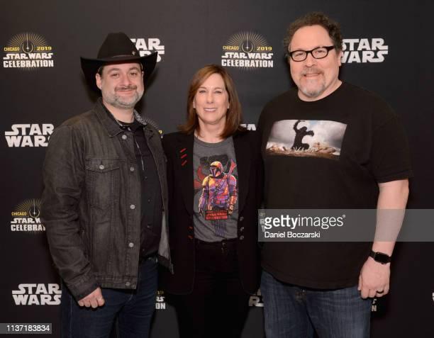 "Director/executive producer Dave Filoni, Executive producer Kathleen Kennedy and Writer/executive producer Jon Favreau attend ""The Mandalorian"" panel..."