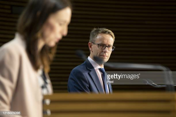 DirectorGeneral of health Dr Ashley Bloomfield listens to Prime Minister Jacinda Ardern at Parliament on May 25 2020 in Wellington New Zealand...