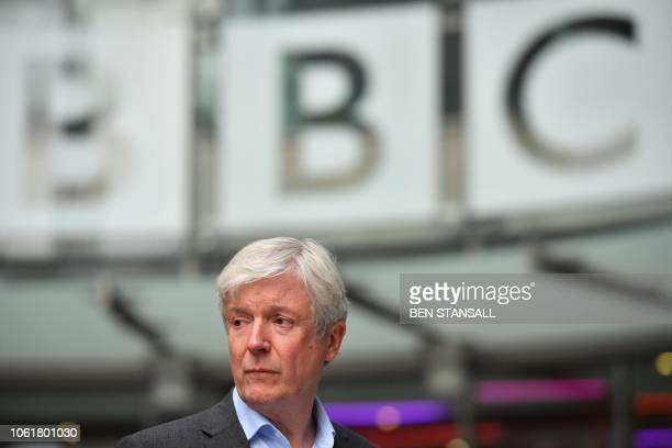 Director-General of the BBC Tony Hall is seen waiting to greet Britain's Prince William, Duke of Cambridge, and Britain's Catherine, Duchess of...