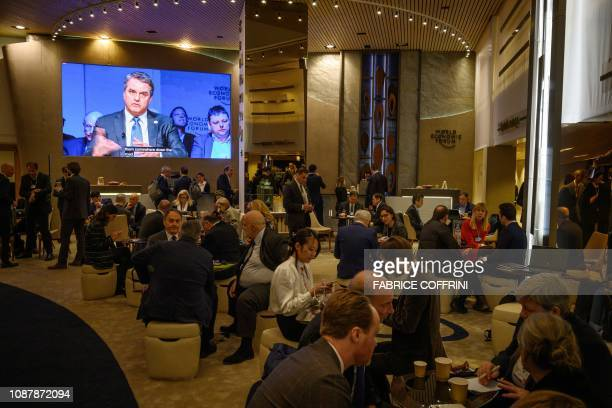 DirectorGeneral of the World Trade Organization Roberto Azevedo is seen on a giant screen in the lobby of Congress centre during the World Economic...