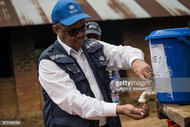 DirectorGeneral of WHO Tedros Adhanom Ghebreyesus washes his hands before visiting an Ebola treatment centre in Itipo on June 11 2018 The director...