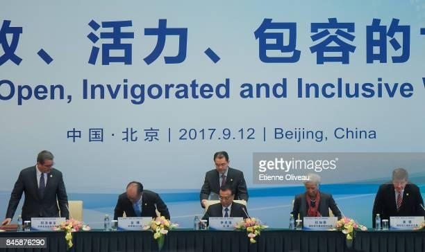 Director-General Roberto Azevedo of the World Trade Organization, President Jim Yong Kim of the World Bank, Chinese Premier Li Keqiang, Managing...