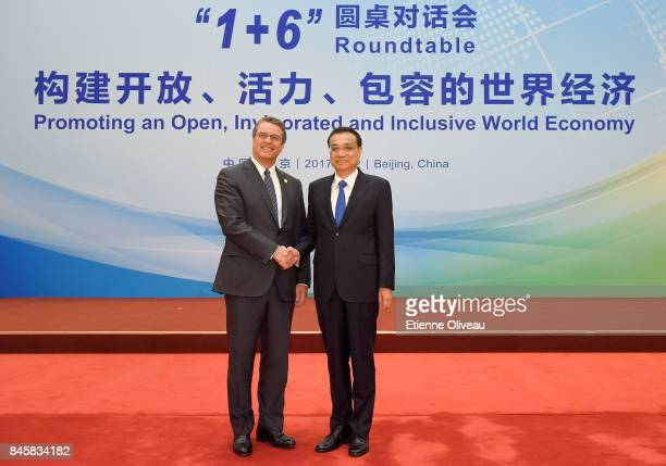 Director-General Roberto Azevedo of the World Trade Organization shakes hands with Chinese Premier Li Keqiang before The 1+6 Round Table Dialogue...